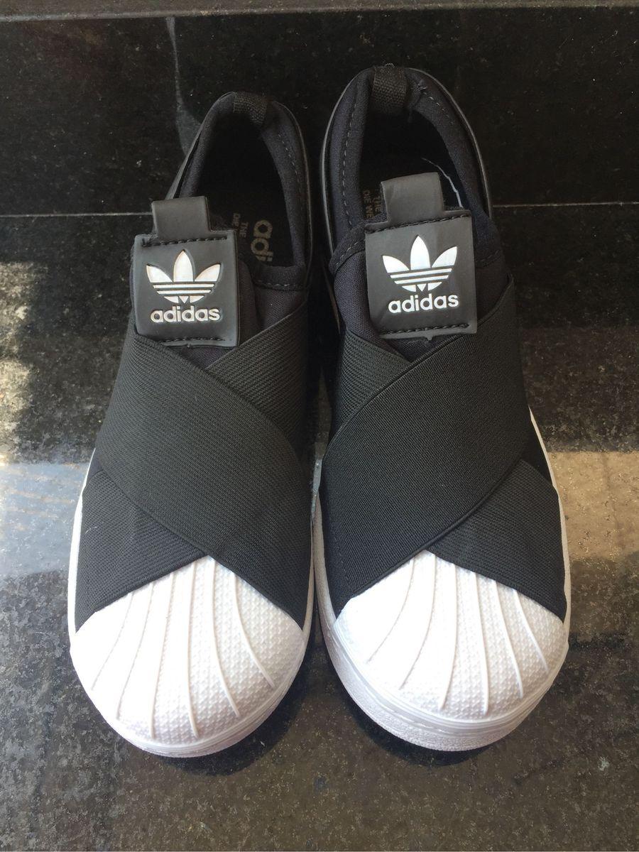 18d64f6e9 adidas slip on preto elastico - tênis adidas.  Czm6ly9wag90b3muzw5qb2vplmnvbs5ici9wcm9kdwn0cy84mde4lzi2m2fjmwziodmzzmy4odkzmwjinjzmngqwzgy5nteylmpwzw  ...