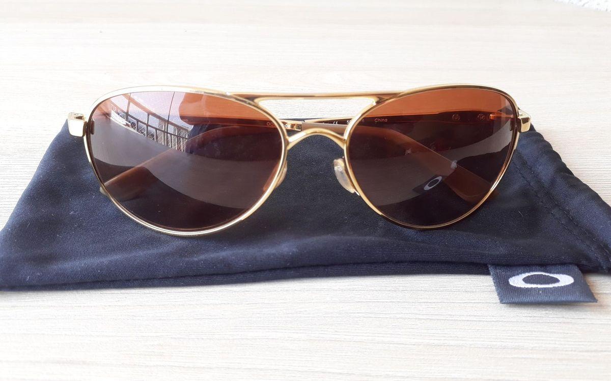 c1cb2da3723a4 aviador oakley original - óculos oakley.  Czm6ly9wag90b3muzw5qb2vplmnvbs5ici9wcm9kdwn0cy8yntc2nzcvm2njzdayztqwnjcxzjdknzq0ntewyty2yty5odmzmziuanbn  ...