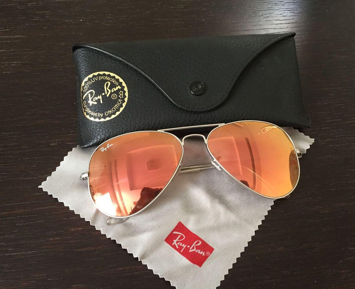 1423ff485 aviador ray ban espelhado - óculos ray-ban.  Czm6ly9wag90b3muzw5qb2vplmnvbs5ici9wcm9kdwn0cy80mdm1mtivyzbhywvlzddizgu4ngexnmrlnthjzmu5n2zmztq0zjguanbn