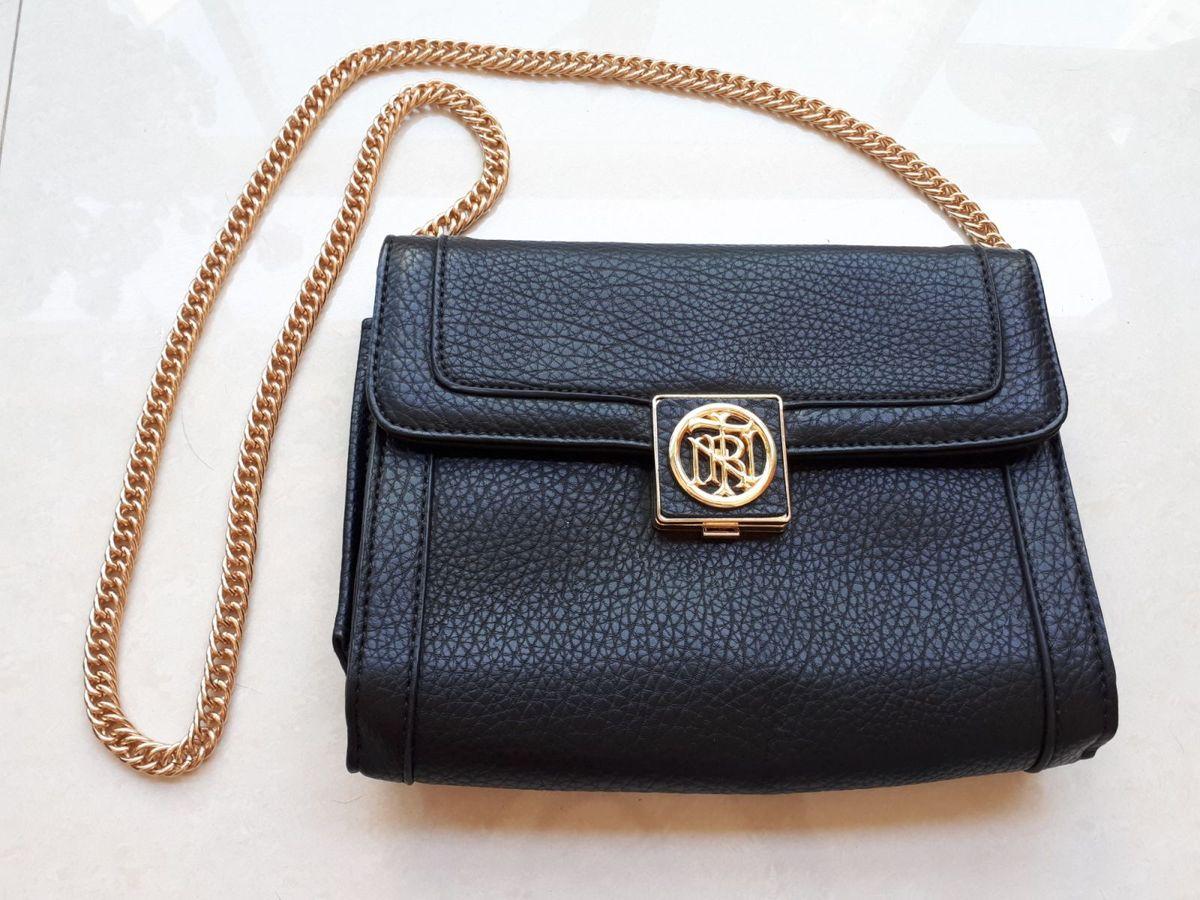 62a787ee8 bolsa de couro preta com alca e fechamento em metal dourado triton original  nova - ombro