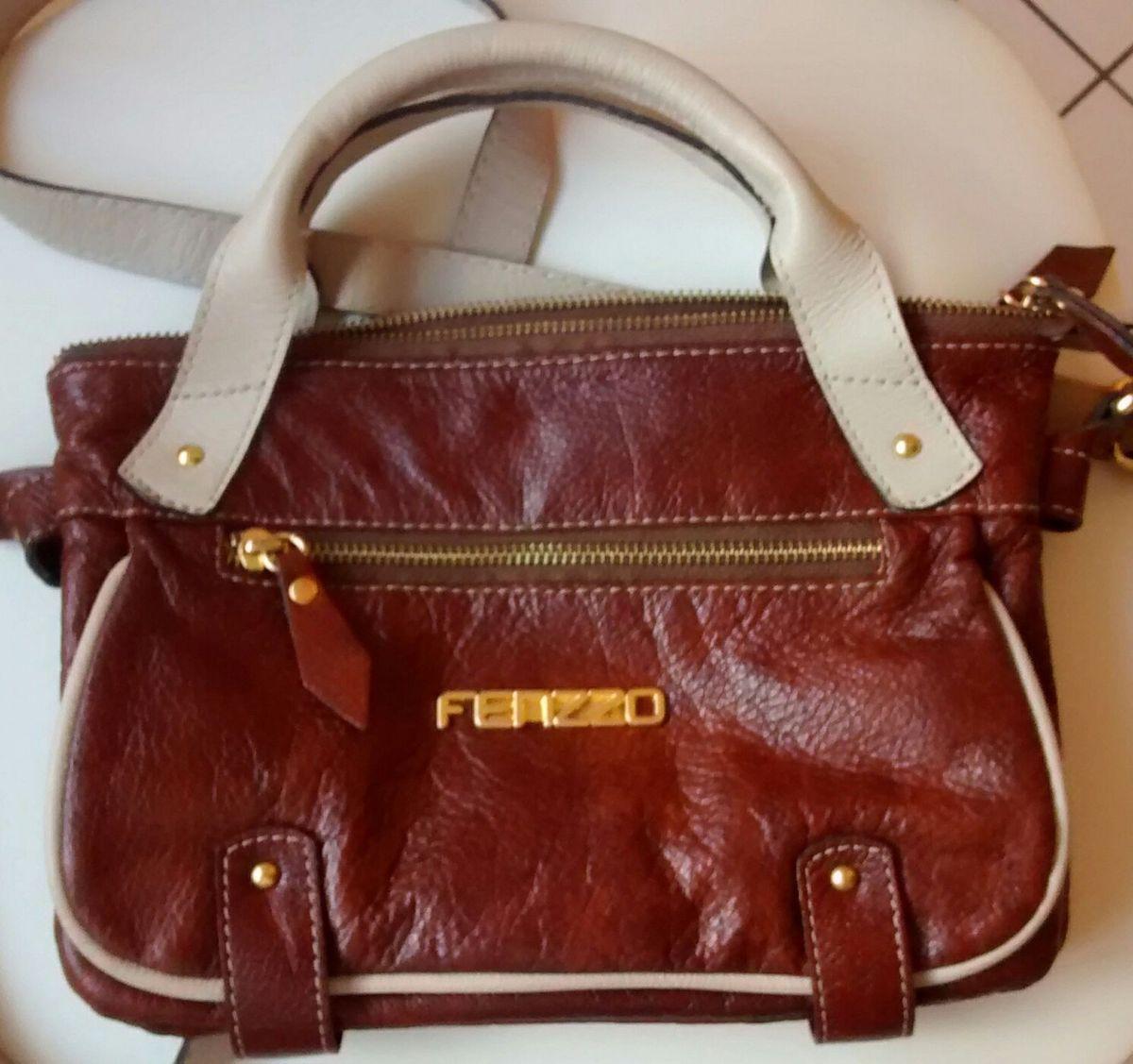 75e9502a4 bolsa fenzzo - de mão fenzzo.  Czm6ly9wag90b3muzw5qb2vplmnvbs5ici9wcm9kdwn0cy8zotiznjivnjcymjazzdnlyzk0yjq0ymfiyzk2mmfhyjc0zjgwyzcuanbn