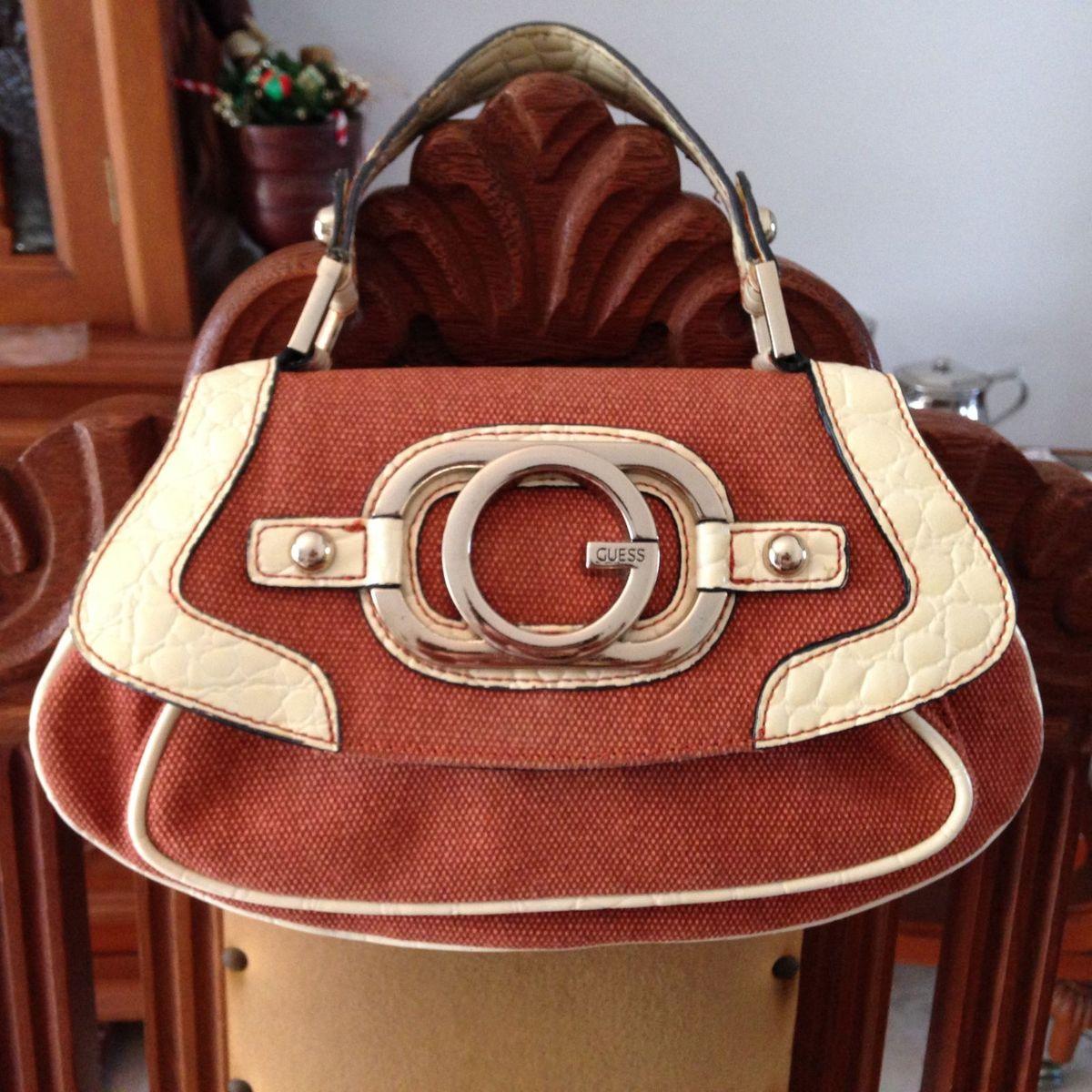8361480f564 Bolsa Guess Original Bolsa de Mão Divisórias Cor Creme e Laranja Grife  Fashion