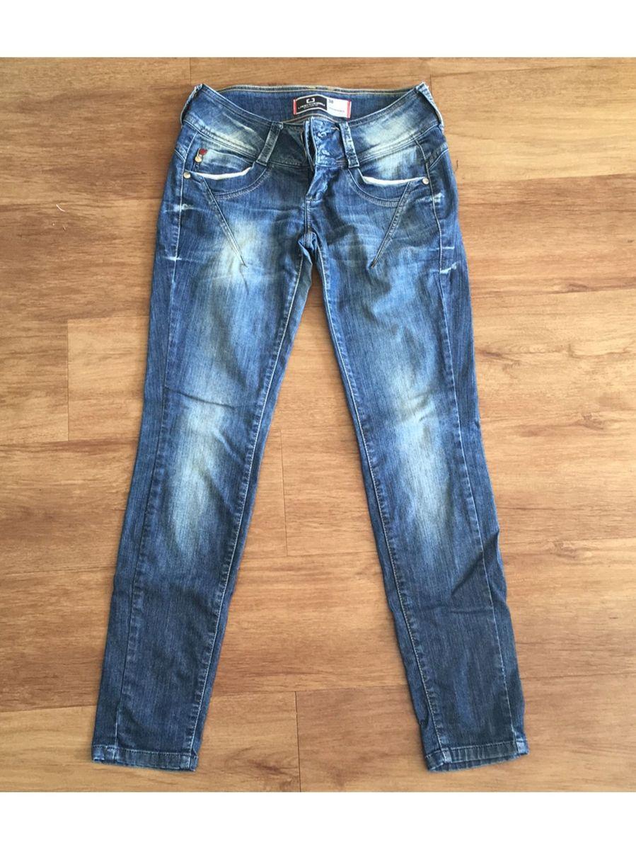 8d31415ee Calça Jeans Cintura Baixa Lado Avesso | Calça Feminina Lado Avesso ...