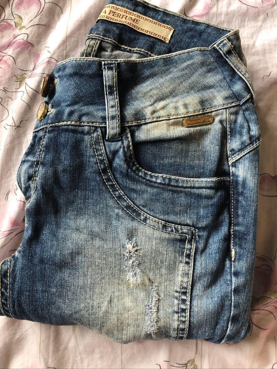 6303e7f1ff calça jeans lança perfume rasgada - calças lanca perfume