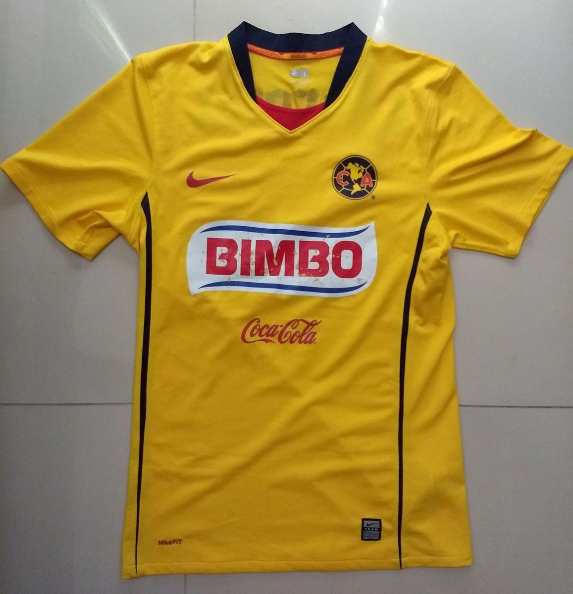 camisa américa do méxico 2008 - esportes nike.  Czm6ly9wag90b3muzw5qb2vplmnvbs5ici9wcm9kdwn0cy84ota4ndkzlzk5njm1zdlhmgewzjgxnzq5mjq5ytlmntnjn2qxmtnllmpwzw  ... 71a17d875c3e4
