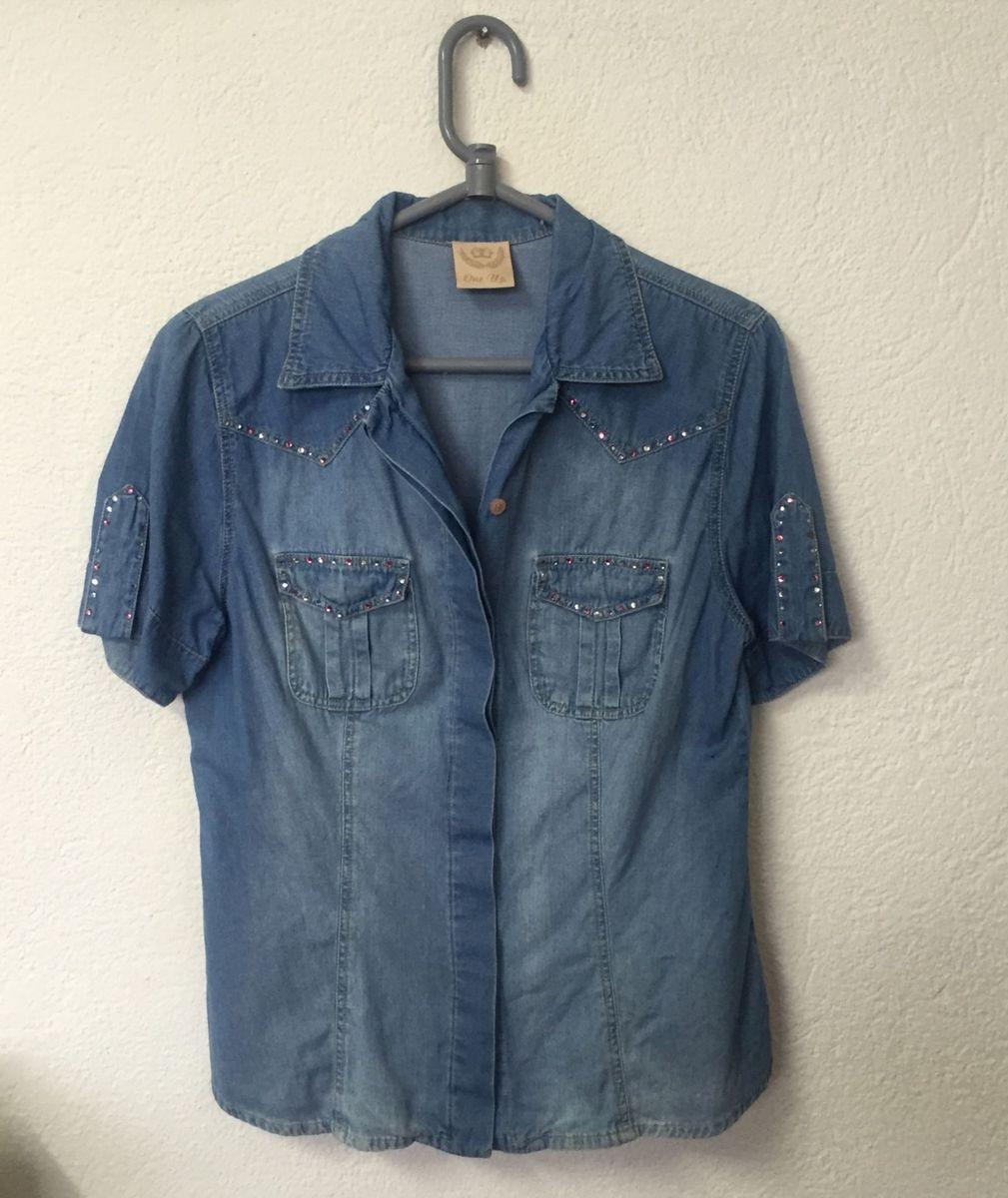 81766abae5 camisa jeans manga curta - blusas one up.  Czm6ly9wag90b3muzw5qb2vplmnvbs5ici9wcm9kdwn0cy81mtmznjk2l2ezn2e3mtk2zwq1yzkxndmynze3ntnlntnkmzzhmdc0lmpwzw