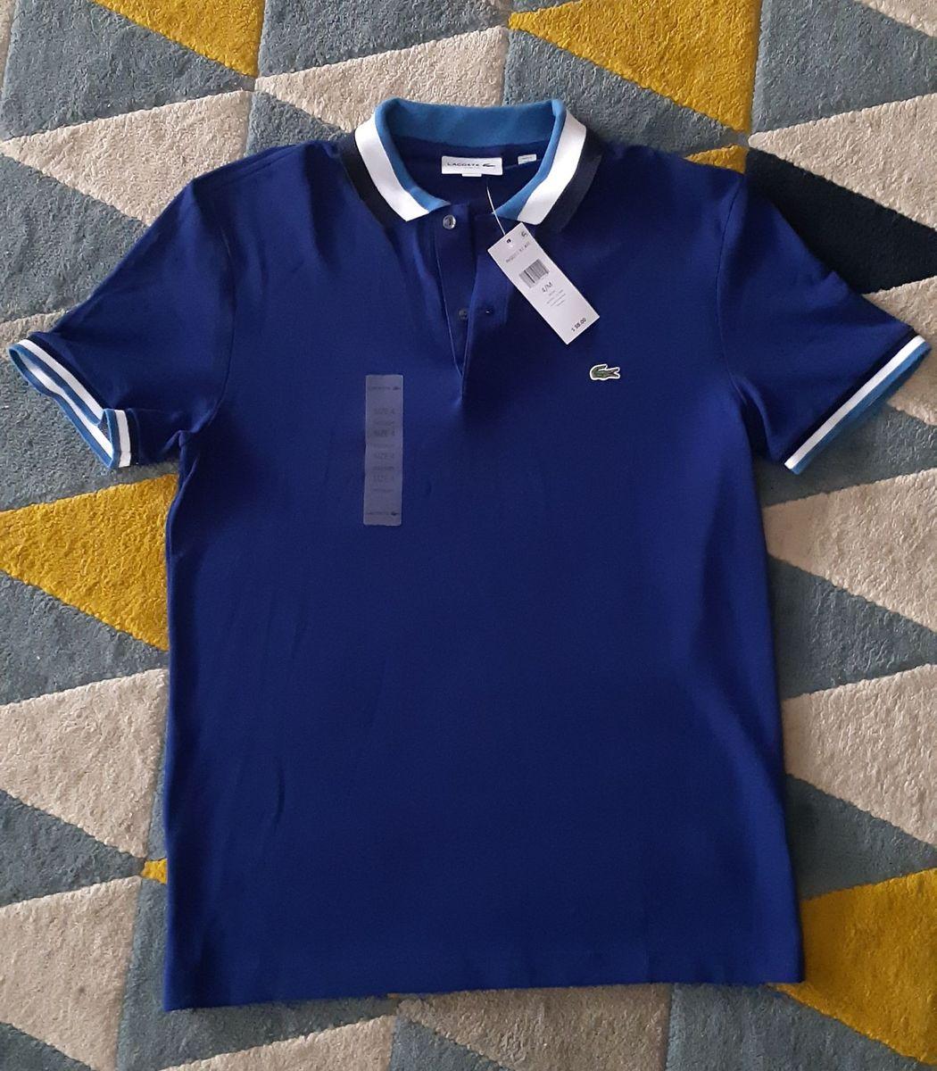 camisa lacoste azul nova - camisas lacoste.  Czm6ly9wag90b3muzw5qb2vplmnvbs5ici9wcm9kdwn0cy85ndkxnti1l2ywzmixyznlmji4yzm2mzrhzgfmngi1yjllmzmxnjmwlmpwzw  ... 35066dd69e