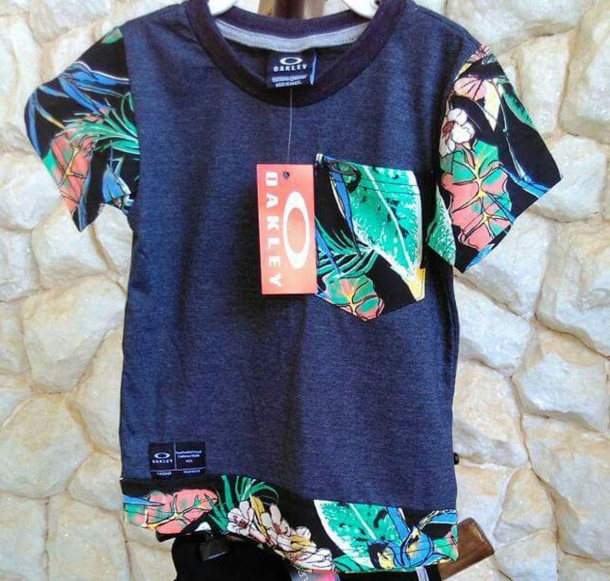 camisa oakley - menino oakley.  Czm6ly9wag90b3muzw5qb2vplmnvbs5ici9wcm9kdwn0cy81mduwmtywlzk3odq5otiwowzlmtcyytm4yjixnjyxntnlogfjnznilmpwzw 233763a0cbece