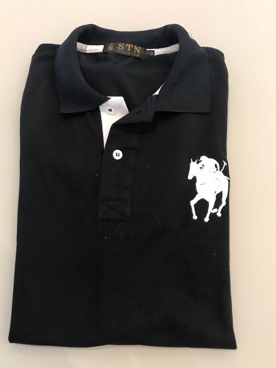 camisa polo preta com detalhe em branco da marca stn - camisas stn  collection bed25d06bdd19