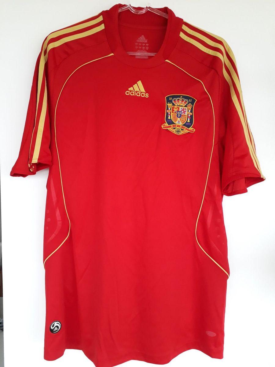 camisa seleção espanha - esportes adidas.  Czm6ly9wag90b3muzw5qb2vplmnvbs5ici9wcm9kdwn0cy85odq0nje0lzllodlkzmmyzjfjmdk2ntgyngu4nwiyyze1ndaxmti3lmpwzw  ... 68b400bc09be9