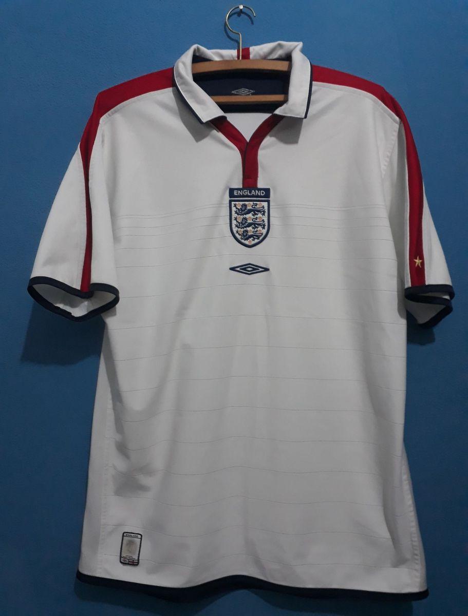 88fa233725 camisa seleção inglesa - camisas umbro.  Czm6ly9wag90b3muzw5qb2vplmnvbs5ici9wcm9kdwn0cy85mzkwmtu2lzhhzgiwm2i5ytexm2e2ndu1nza3zta3mdjlmwnkotdhlmpwzw  ...