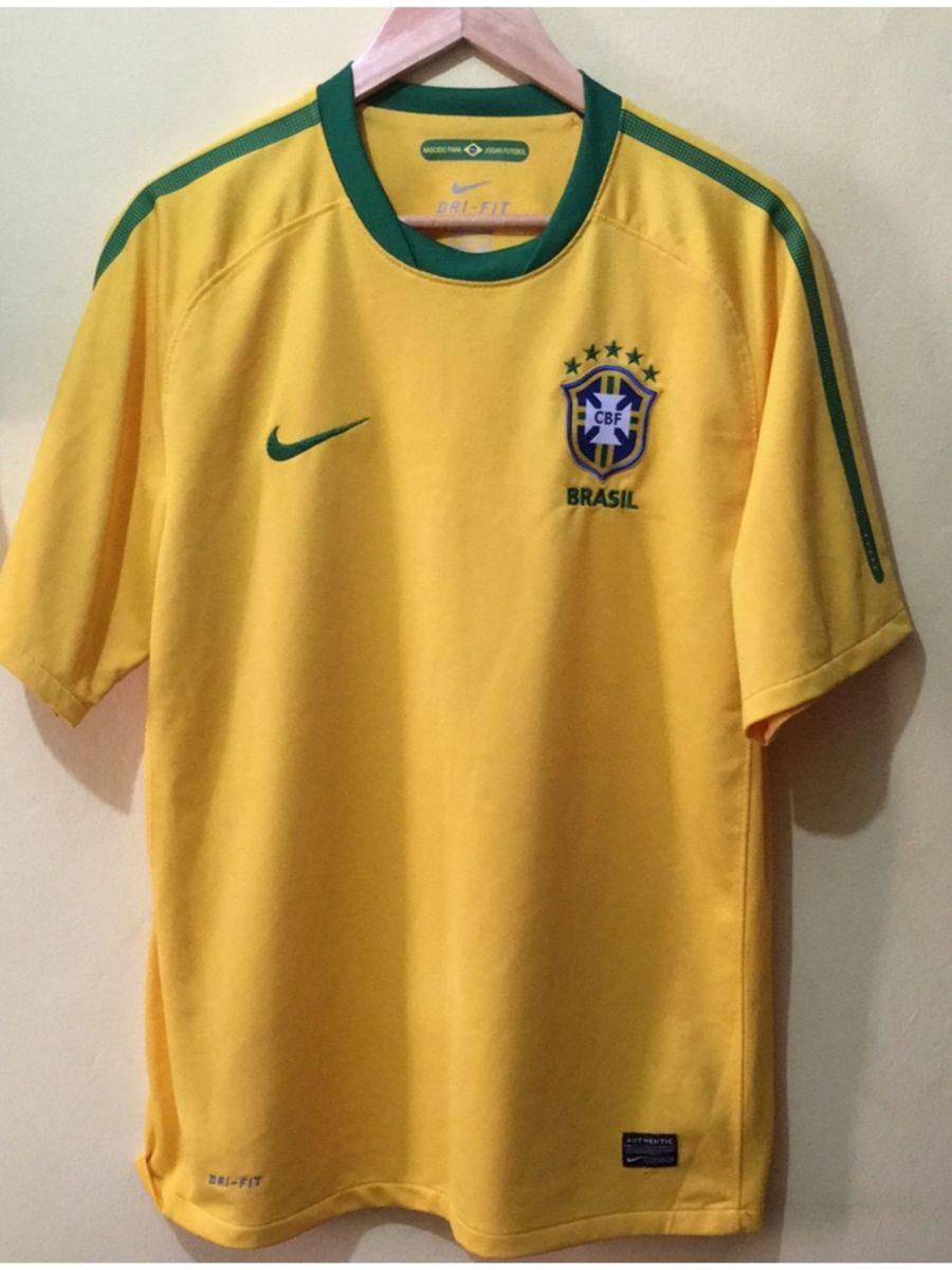 camiseta brasil original nike - esportes nike.  Czm6ly9wag90b3muzw5qb2vplmnvbs5ici9wcm9kdwn0cy80otcwnjgvnzc3odnkmjcwyjixnjnjotzjota2ymiynwe0othjyziuanbn  ... 458a682e63ade