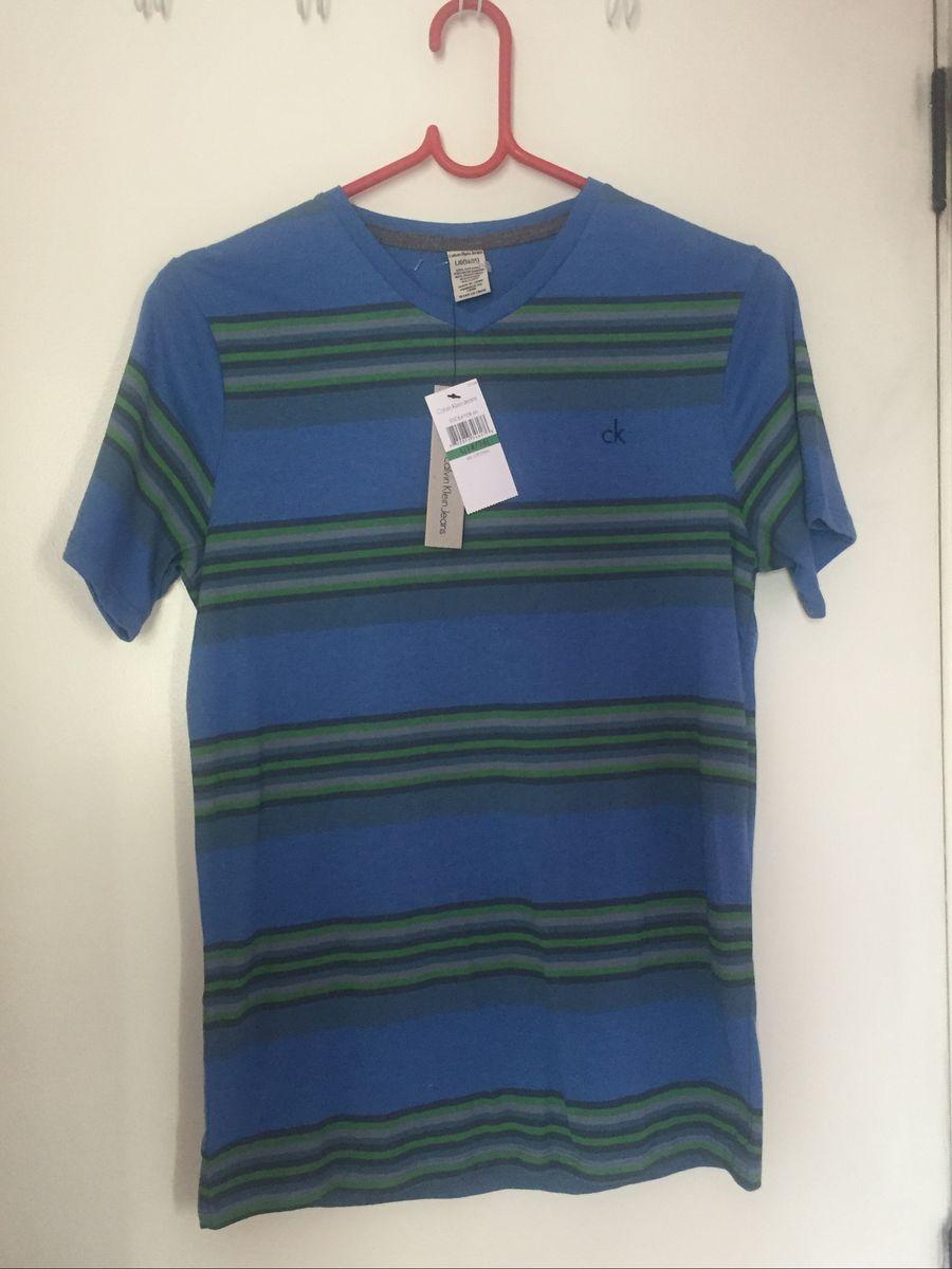 1d5ec2b3b850c camiseta calvin klein original sem uso - menino calvin-klein