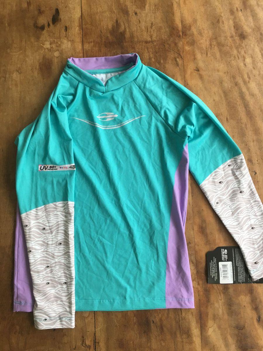 7b4fc75e8 camiseta de lycra infantil proteção uv50 - mormaii - menina mormaii