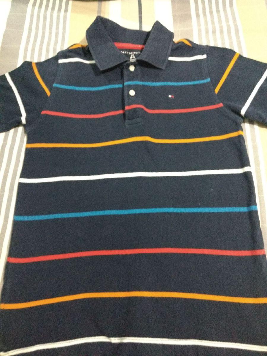 camiseta polo 6-7 - menino tommy hilfiger.  Czm6ly9wag90b3muzw5qb2vplmnvbs5ici9wcm9kdwn0cy82nty1oc9iyzzmmdu4n2zjmzm3mdu3ngnhztc3ndk4njq2n2mwmc5qcgc  ... 88b4b17e08a47