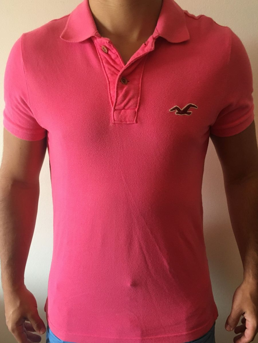 camiseta pólo rosa - camisetas hollister.  Czm6ly9wag90b3muzw5qb2vplmnvbs5ici9wcm9kdwn0cy83odkxmy9kngq3nda4mjrmodc0yjy1zgy3odgxmdg4mmi3ytq2oc5qcgc  ... 2834a4445de21