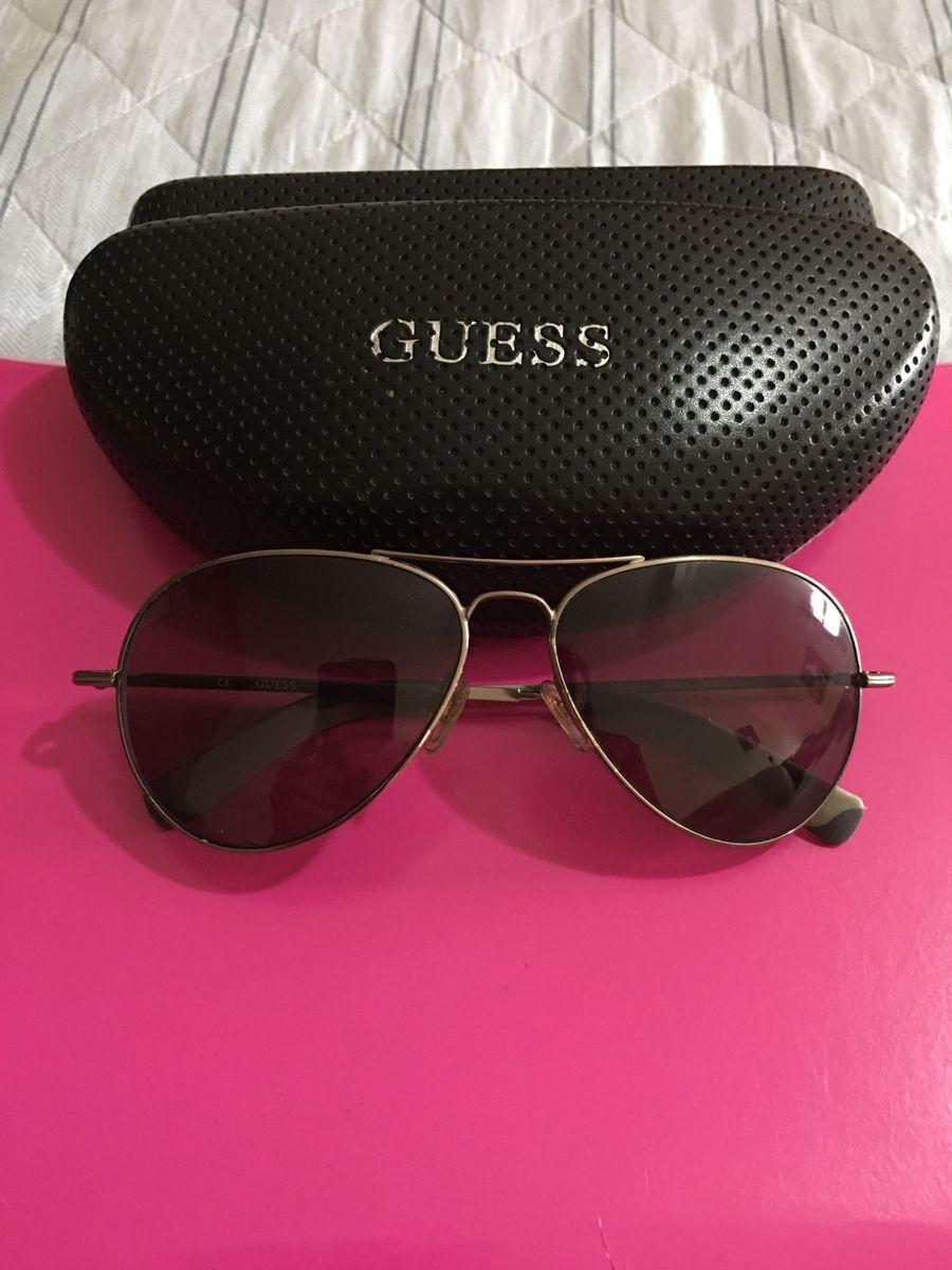 c71635c6effe8 guess aviador - óculos guess.  Czm6ly9wag90b3muzw5qb2vplmnvbs5ici9wcm9kdwn0cy84njmxotmvowmzmduwztiyn2rimmnlmjq3mjc3mgrim2mxmwvjzgeuanbn  ...
