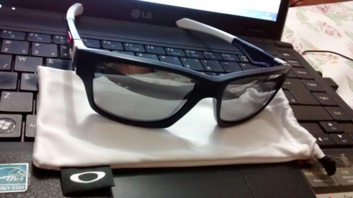 2c16e5c201 oakley jupiter squared matte navy chrome iridium - óculos oakley