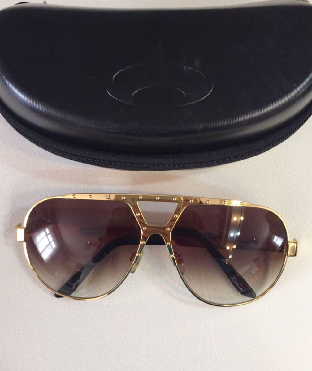 2c5e1109486a2 óculos aviador dourado da evoke - óculos evoke.  Czm6ly9wag90b3muzw5qb2vplmnvbs5ici9wcm9kdwn0cy85mdi1njuvnmqwmzg5zjfiyzy2mdg4mzc2n2y5zdgyntqxmtqzzjuuanbn  ...