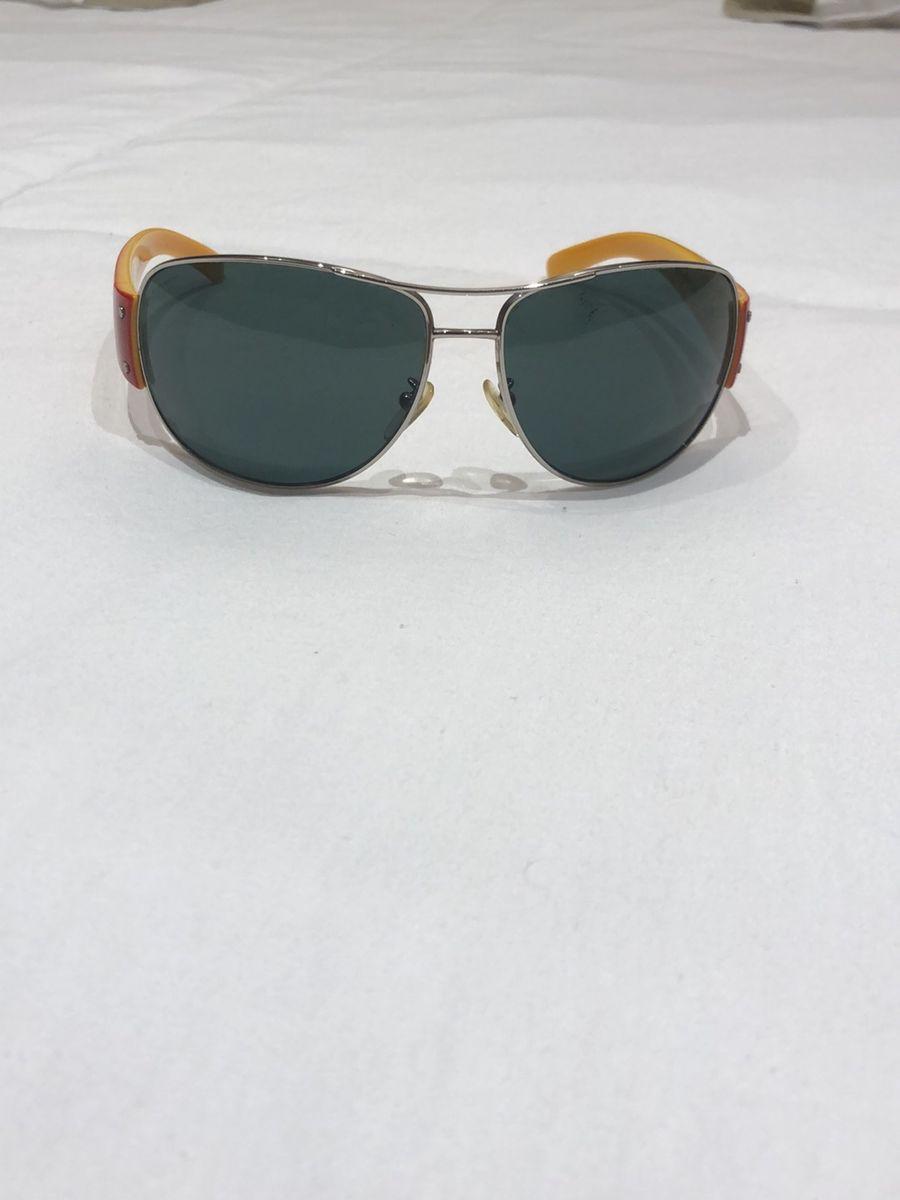76c3f3df8 óculos aviador prada - óculos prada.  Czm6ly9wag90b3muzw5qb2vplmnvbs5ici9wcm9kdwn0cy85otg4ote0l2zjzjjlmmnmzgi1zjnmowzindq3zmy3ngmxm2i3mjkzlmpwzw