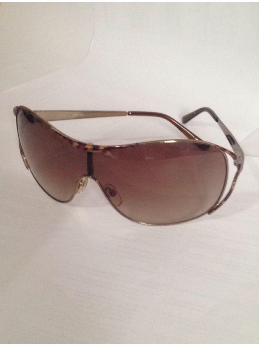4a294ada4 óculos de sol guess original - óculos guess.  Czm6ly9wag90b3muzw5qb2vplmnvbs5ici9wcm9kdwn0cy85ndawodgwl2izmjhhnjkyn2y5otawzwi2mwy1ywzhnddkzti5mjfhlmpwzw
