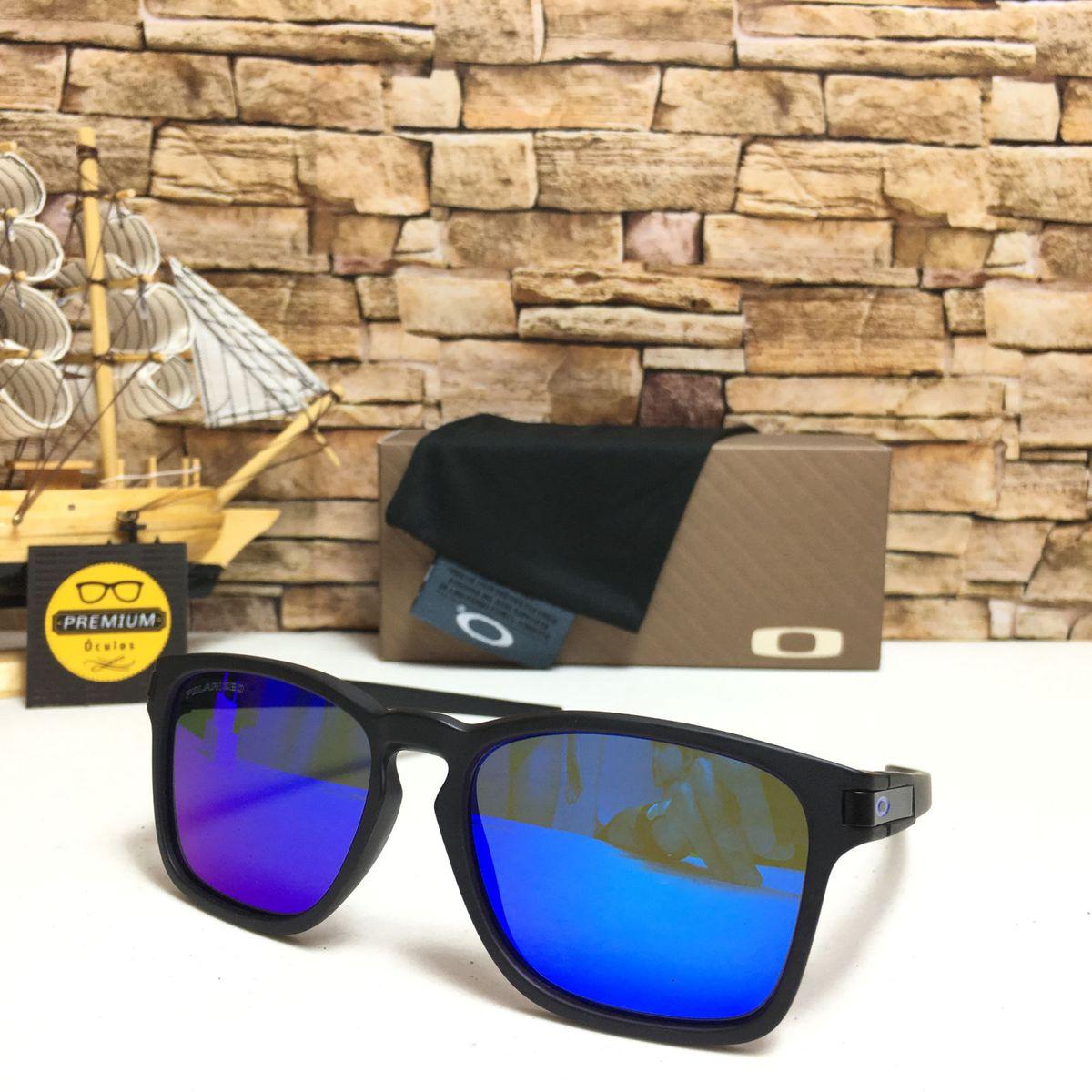 oculos de sol latch squared azul - óculos oakley.  Czm6ly9wag90b3muzw5qb2vplmnvbs5ici9wcm9kdwn0cy81mjy2mdc0lzjlyjyznte4mjuyntixodi3ogjhnmzhotnmzmywmdfmlmpwzw  ... 6a32895ef6