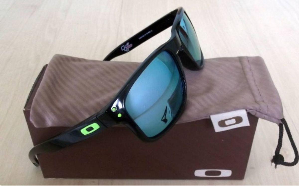 0f8ad7ed21ba9 óculos de sol oakley hobrook azul espelhado - óculos oakley