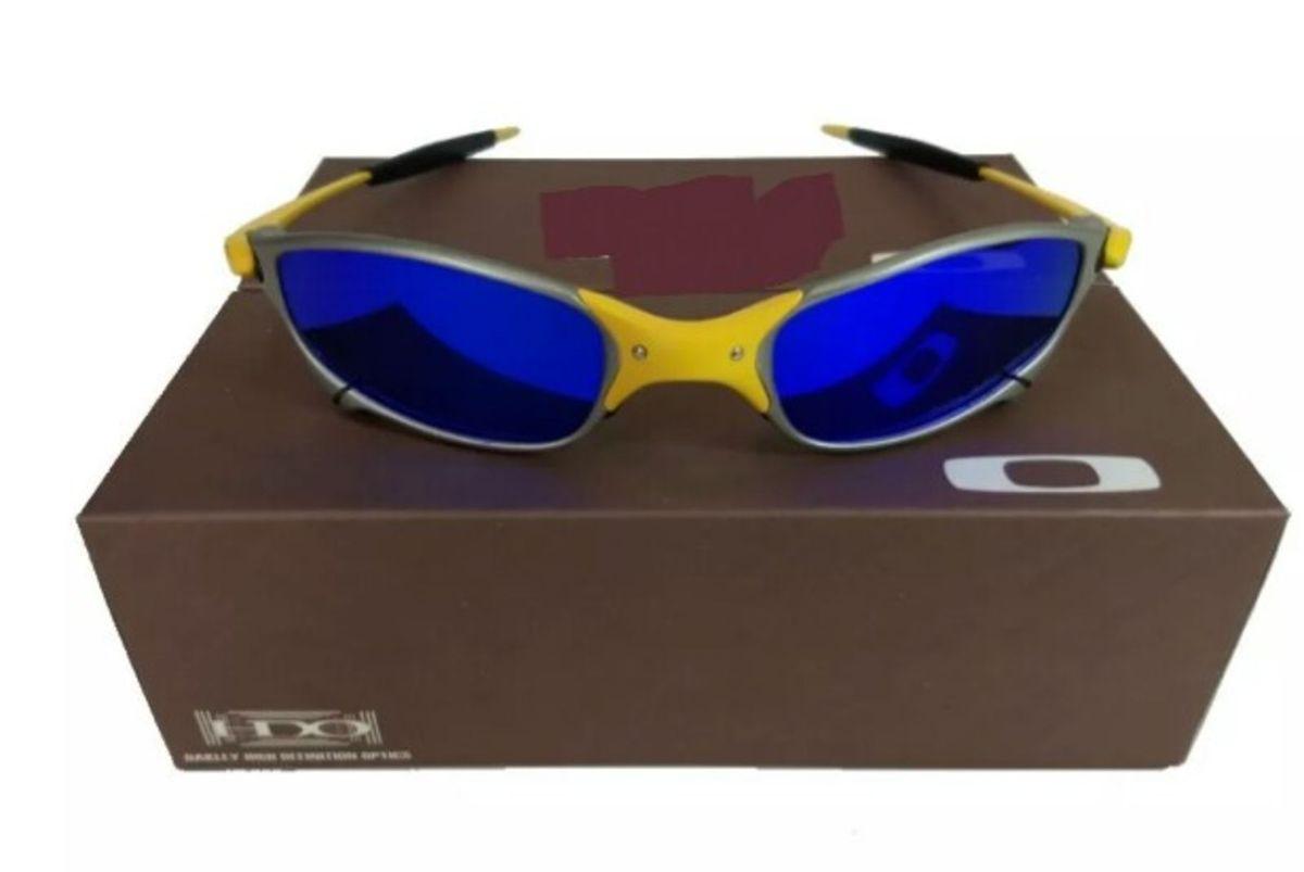 óculos de sol oakley juliet 24k lente azul xmetal novo na caixa - óculos  oakley 3d6af15389