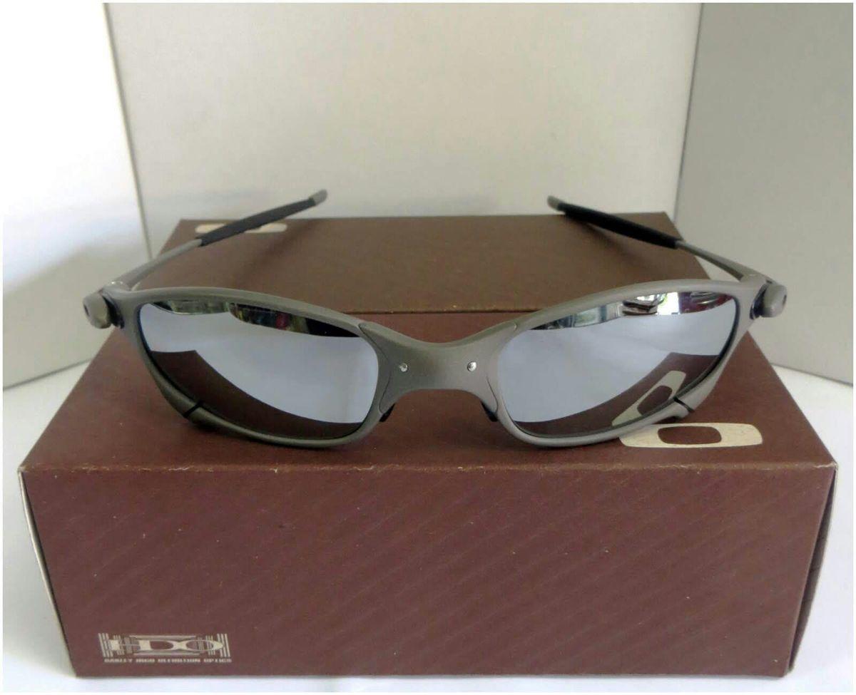 f3306110d57fc óculos de sol oakley juliet espelhada xmetal novo na caixa - óculos oakley