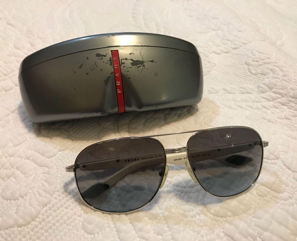d218d2363 oculos de sol - prada - óculos prada.  Czm6ly9wag90b3muzw5qb2vplmnvbs5ici9wcm9kdwn0cy82nja5mdi0lzvhy2q5n2uymtlkntcwzjgzmtewzdiymtvkyzcwowiylmpwzw