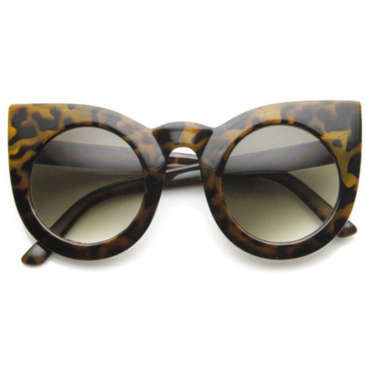 2561c8a799dc8 Óculos Gatinho Redondo Oversize