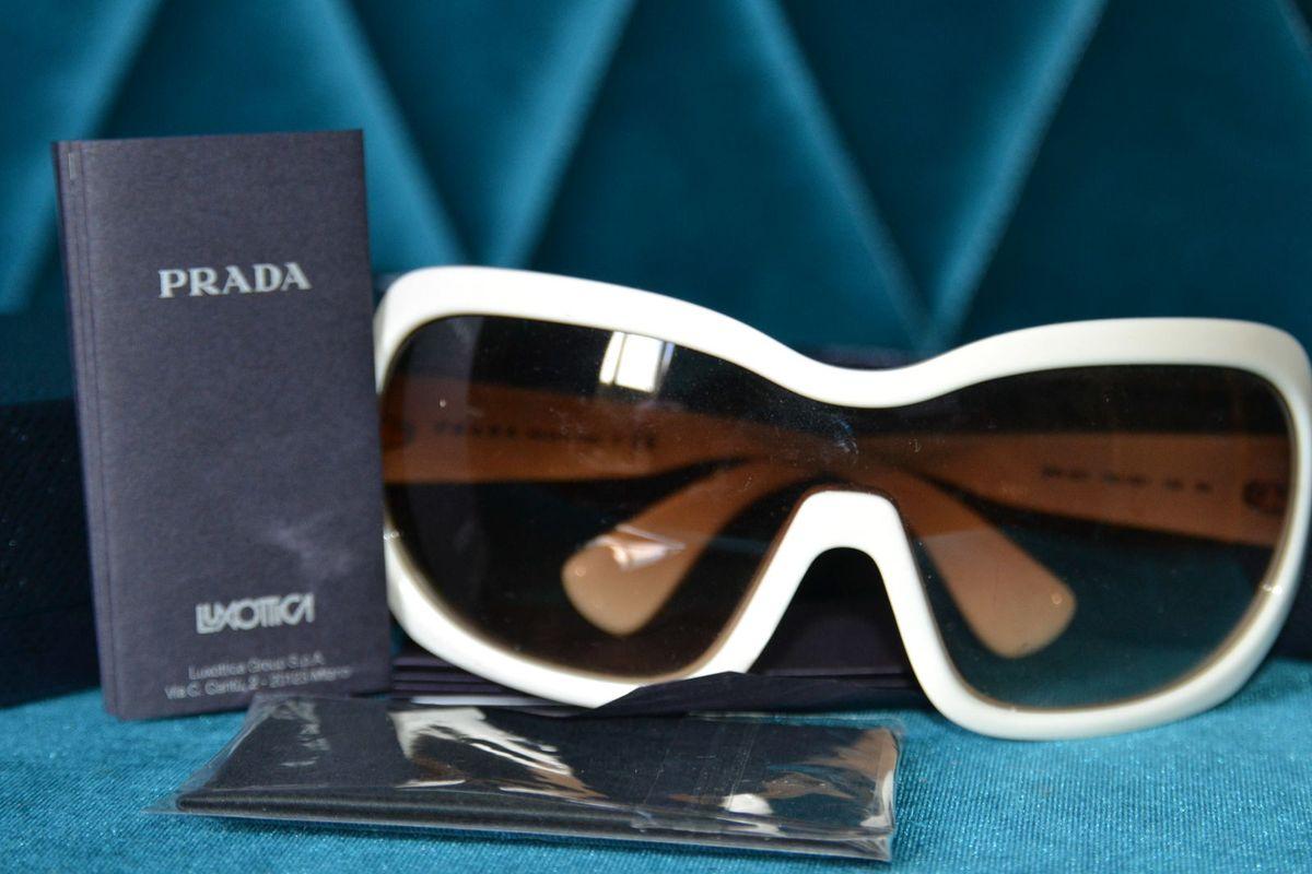 óculos marfim prada original - óculos prada.  Czm6ly9wag90b3muzw5qb2vplmnvbs5ici9wcm9kdwn0cy82nzy3nzmzlzziyjuyymywmzrkmjgznzy0zjlmztc3ztgxngfkotfllmpwzw  ... 94b59a7fed