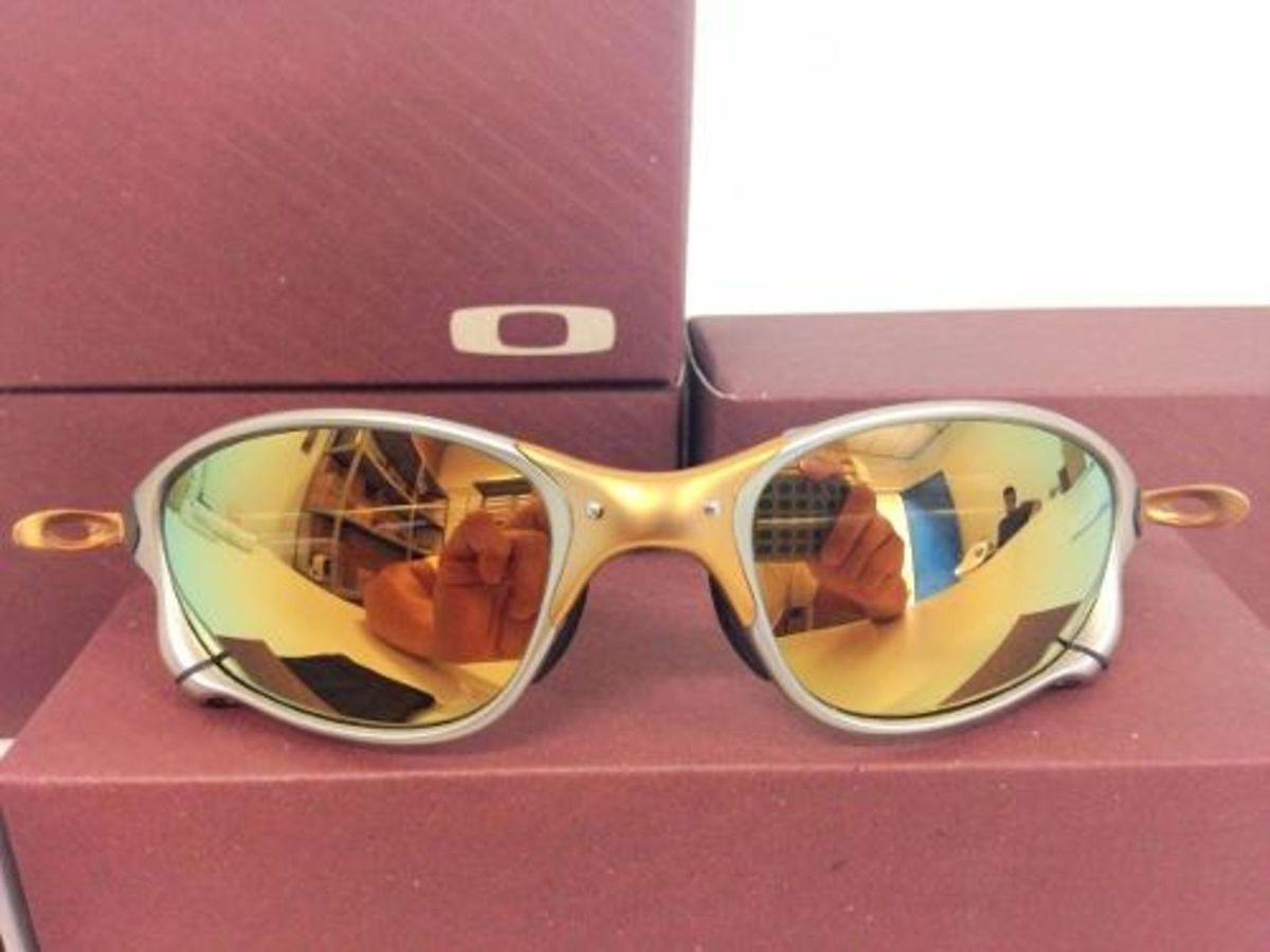 oculos oakley juliet 24k - óculos oakley.  Czm6ly9wag90b3muzw5qb2vplmnvbs5ici9wcm9kdwn0cy82ntmzotkwl2uzzmm2zju3zwi0mjy3ztyyn2fjzmu4ote3ywnimwnilmpwzw  ... 193820cb90