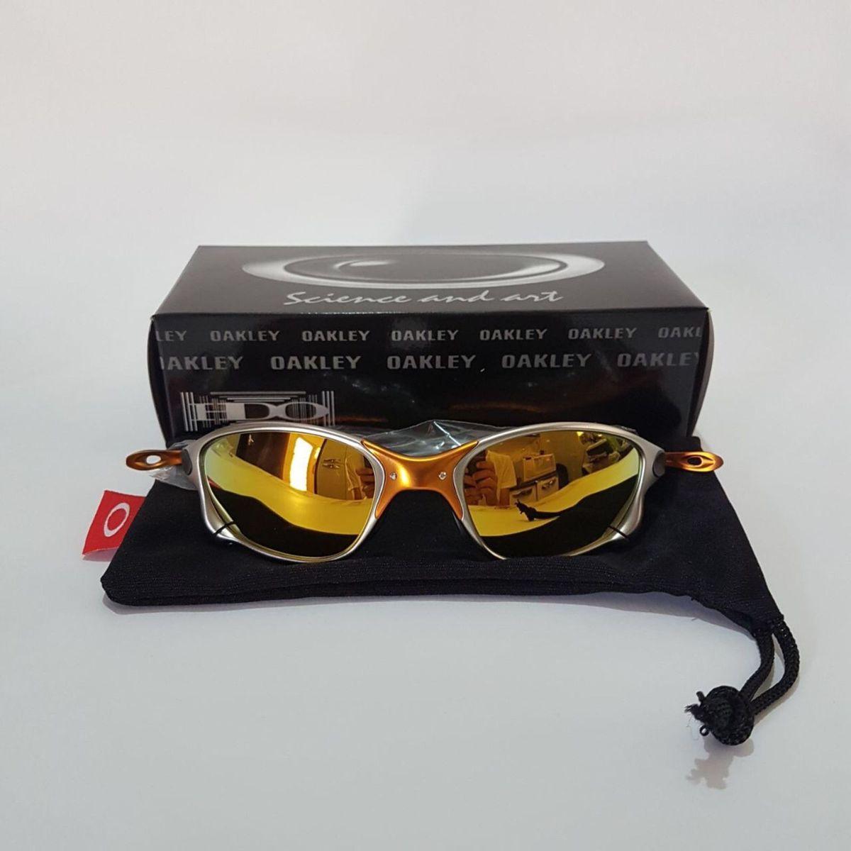 óculos oakley juliet dourado 24k - óculos oakley.  Czm6ly9wag90b3muzw5qb2vplmnvbs5ici9wcm9kdwn0cy81mdq3nzk5lzi1mzc2ndhjntfjngm5ote4mju5nwjjzjvkmdhlmmewlmpwzw 34dd465288
