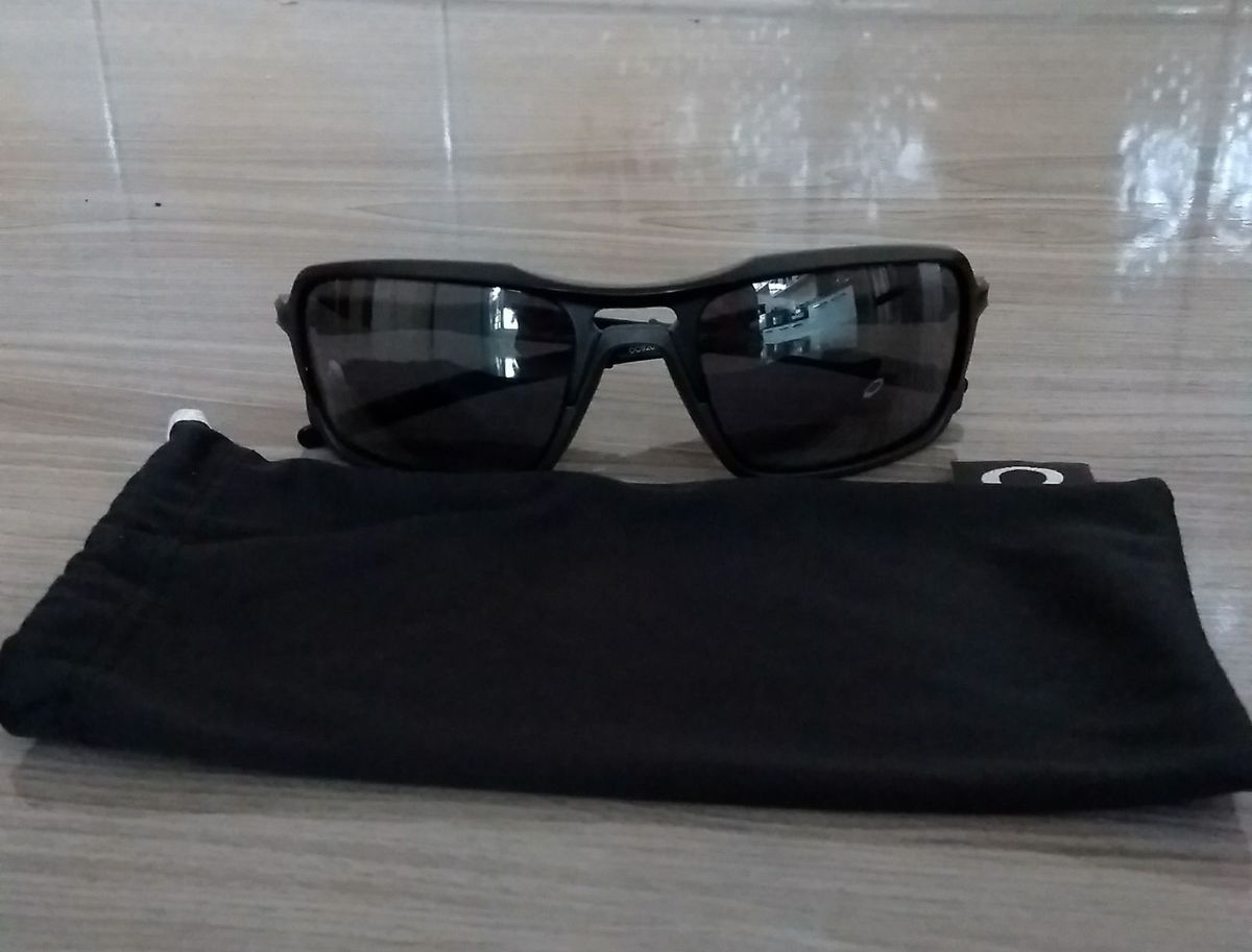 c4df2105b óculos oakley triggerman - óculos oakley.  Czm6ly9wag90b3muzw5qb2vplmnvbs5ici9wcm9kdwn0cy85nzc3odaylzk3ntlizgzhytfhndhkyzk4mju4zjiznzlim2m5m2fmlmpwzw