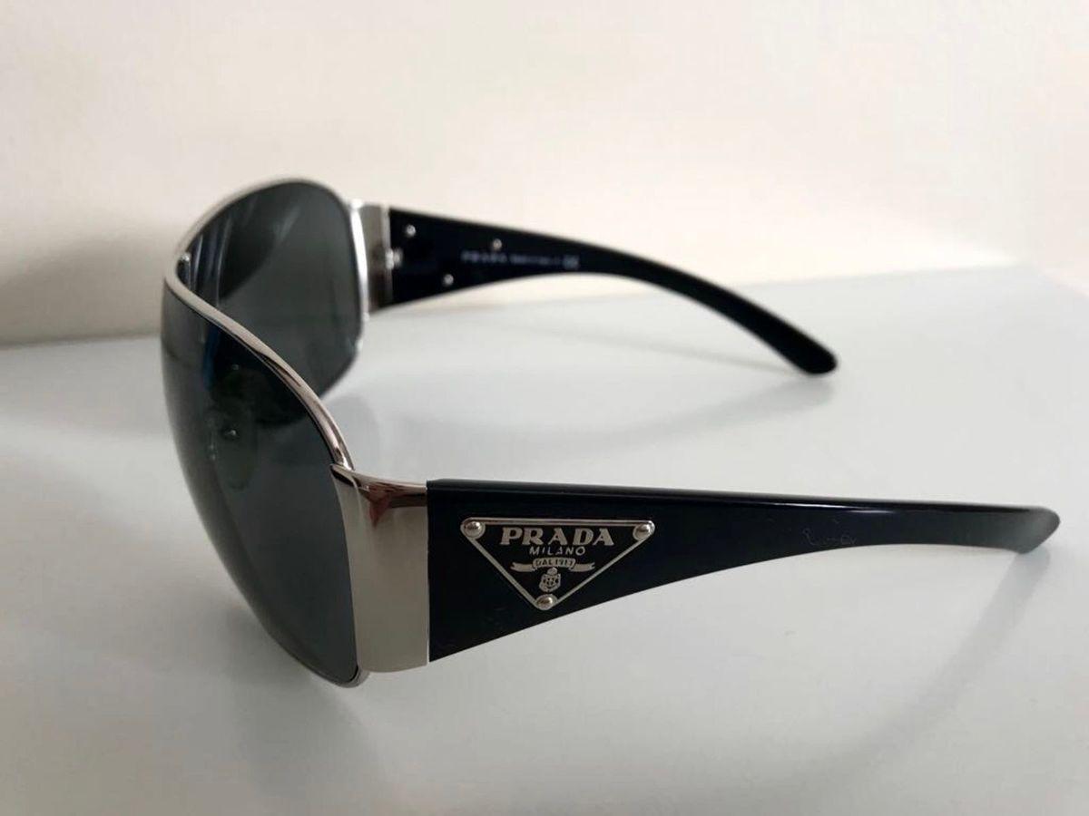 c23bfb362 óculos prada.  Czm6ly9wag90b3muzw5qb2vplmnvbs5ici9wcm9kdwn0cy80nti1ntczl2jiyjnlowuxoty1odaymdc4mtm4mwq1m2u5n2mzmtcylmpwzw  ...