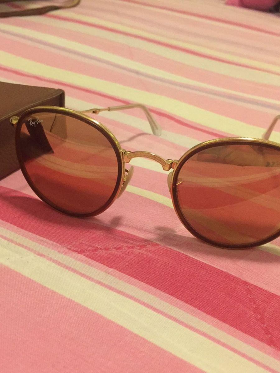 óculos ray ban espelhado rosa - óculos ray ban.  Czm6ly9wag90b3muzw5qb2vplmnvbs5ici9wcm9kdwn0cy82mjkymte5l2yyogq3njzknzrlm2y2zjc5ymixyjawowfhyzi2ytrjlmpwzw  ... afc207a743