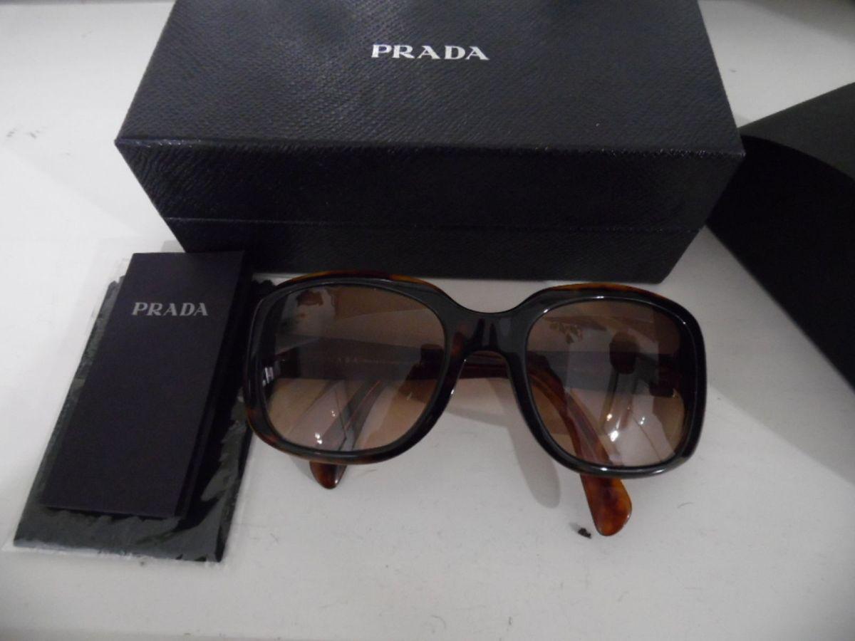 243932fc4 óculos solar prada - óculos prada.  Czm6ly9wag90b3muzw5qb2vplmnvbs5ici9wcm9kdwn0cy81nza0nzqxl2e2nda3zgzjytyymzjlyzk4ytuzmme3yznmztlmmta0lmpwzw