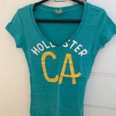 8a15e2244 Hollister Camiseta Feminina 2019 Nova ou Usada
