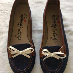 a1ecd2dadd sapatilha de tecido jeans com detalhe em marrom e branco