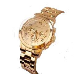 c5213639f relógio michael kors dourado fundo dourado