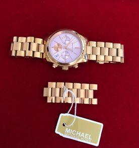 relógio michael kors mk 6163 original fundo lilás. pulseira e caixa na cor  rosê ( d1dfeee36b
