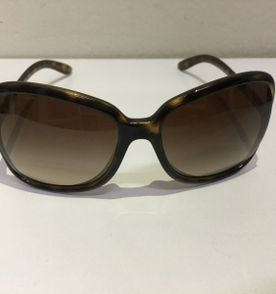 Oculos Prada Marrom - Encontre mais belezas mil no site  enjoei.com ... e9dc6d2fb7