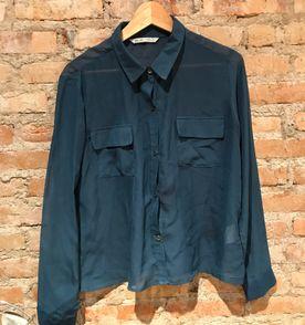 06f152115c camisa com botões transparente azul petróleo
