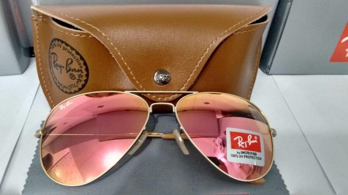 8fd107662e28d ray ban aviador armação dourada lentes rose espelhado - óculos ray-ban
