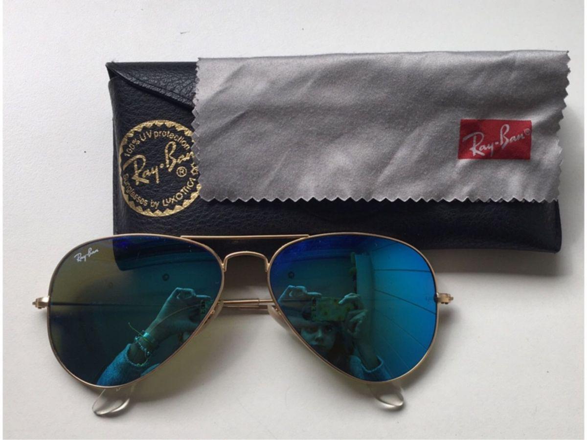 ray ban espelhado azul - óculos ray ban.  Czm6ly9wag90b3muzw5qb2vplmnvbs5ici9wcm9kdwn0cy82njgymdcvmjbkzjq3mwm4ymixmtq2y2m5mgu3otqymtewmdk2odquanbn  ... e2fba1f547