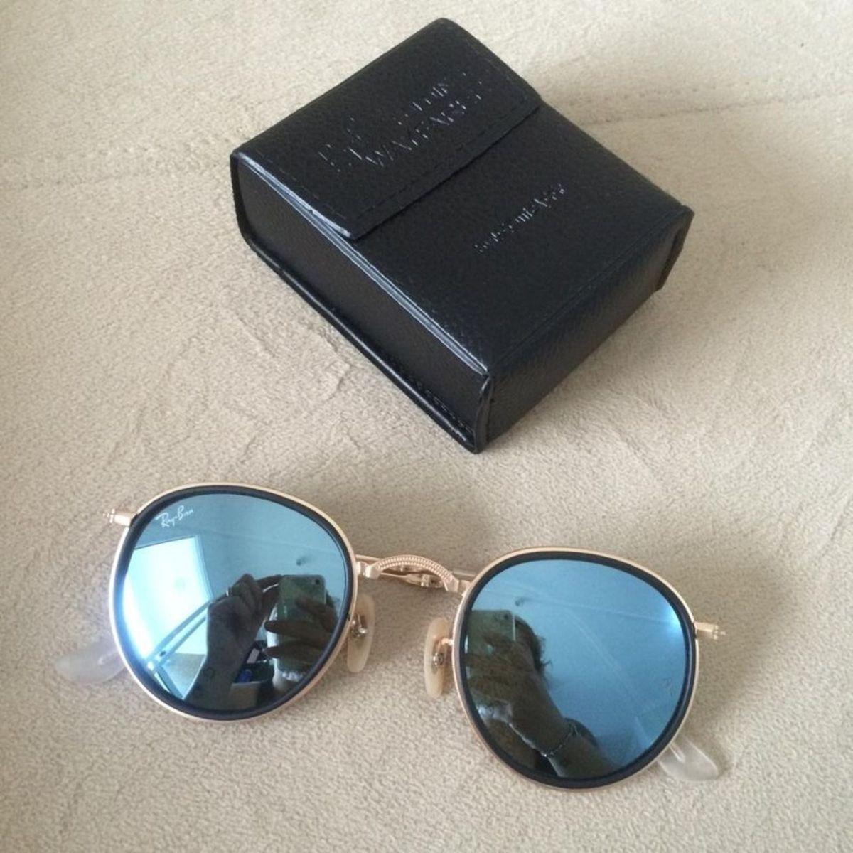 482862642f8f2 ray ban round azul dobrável - óculos ray ban.  Czm6ly9wag90b3muzw5qb2vplmnvbs5ici9wcm9kdwn0cy80nja5mtuxl2rmngvmnjhkmju2m2zkzdhkmjk1otljzty2ngu4nznmlmpwzw  ...