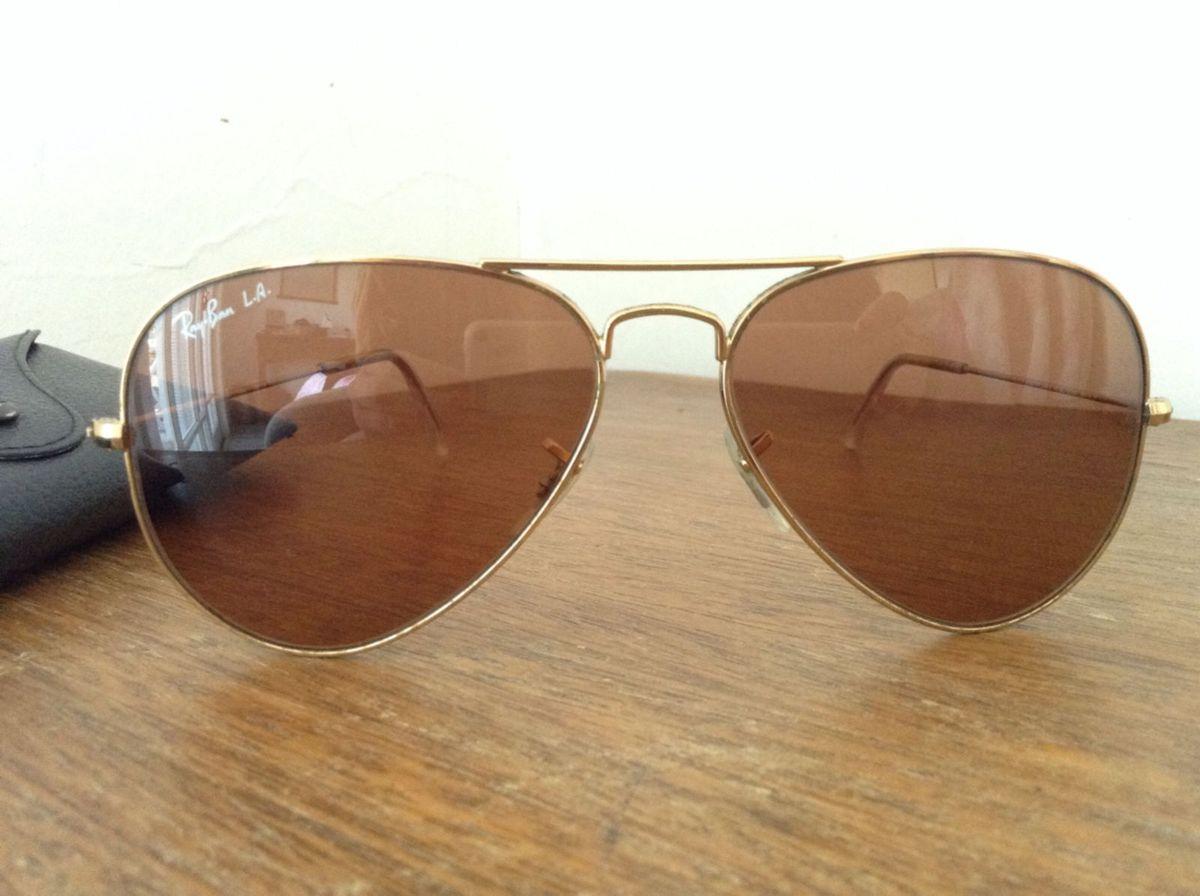 rayban aviador l.a. marrom - óculos rayban.  Czm6ly9wag90b3muzw5qb2vplmnvbs5ici9wcm9kdwn0cy81odm4njavodqyyjm5yzhhotkymmjkzmq2zmqynjhlotuwmzq4mduuanbn  ... 6d80fa8c44