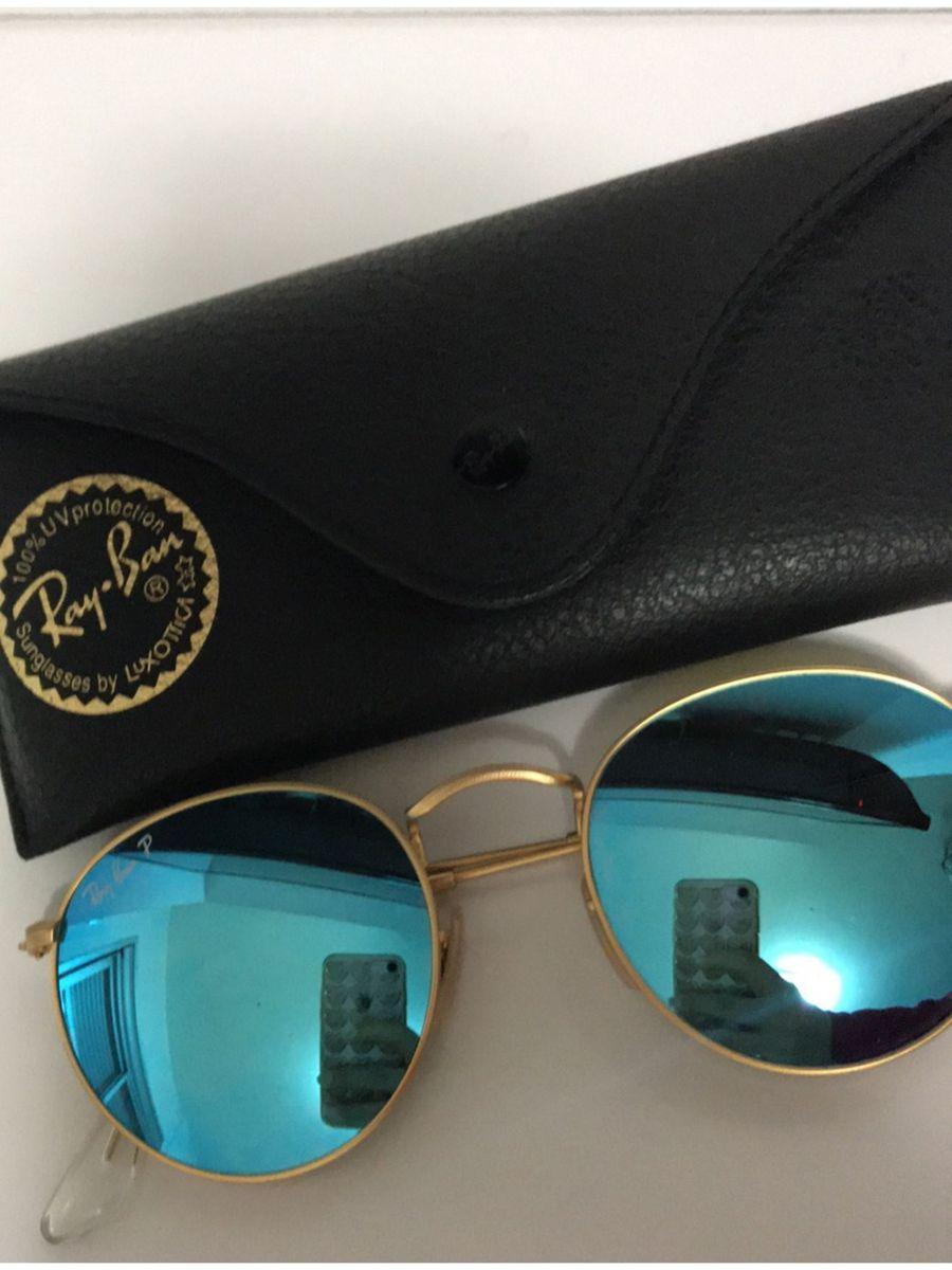 rayban round dourado e azul espelhado redondo polarizado - óculos ray-ban a08c5a8775