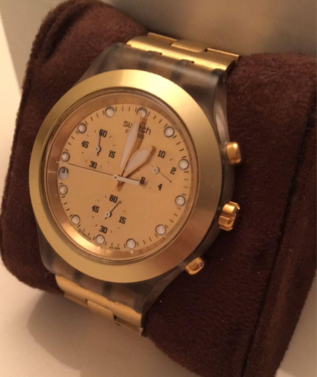 f32718b0885 relógio dourado swatch - relógios swatch.  Czm6ly9wag90b3muzw5qb2vplmnvbs5ici9wcm9kdwn0cy81nza4otczlzuwzmq0mdhhmdrizdjmnzrknjrimwu1yjdkyzg5ogewlmpwzw  ...